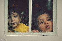 childrens behind the window